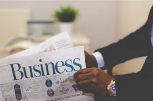Picture of a newspaper with a title called Business