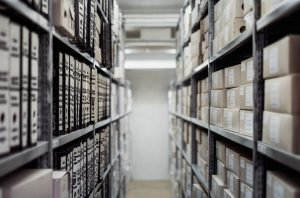Picture of an aisle between two shelves stacked with boxes