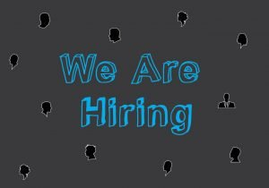 Picture that says we are hiring with black head shots surrounding the words