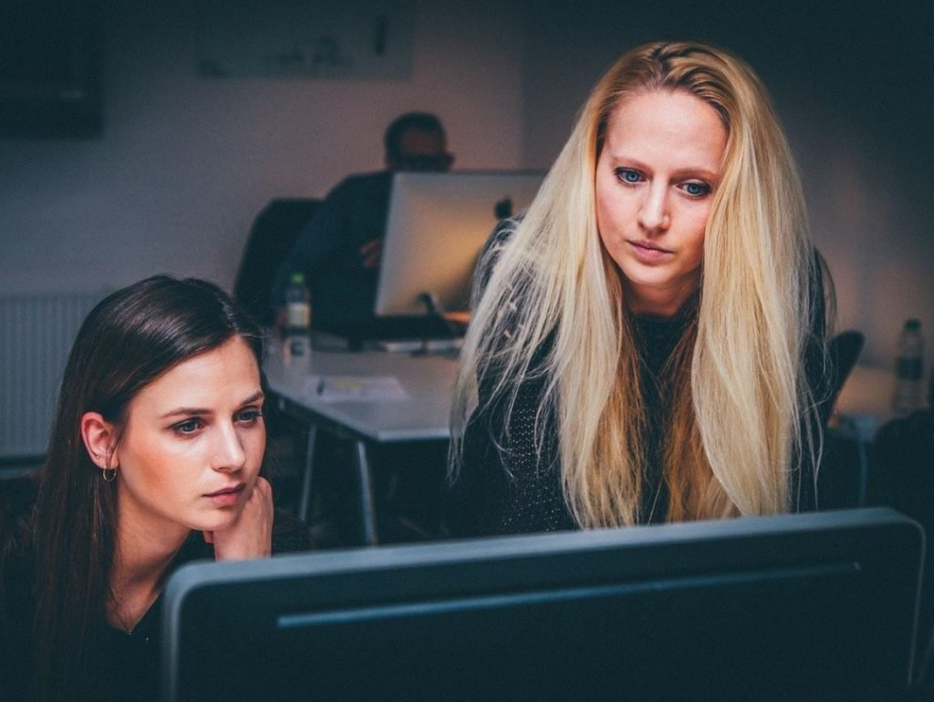 Picture of two women looking at a computer