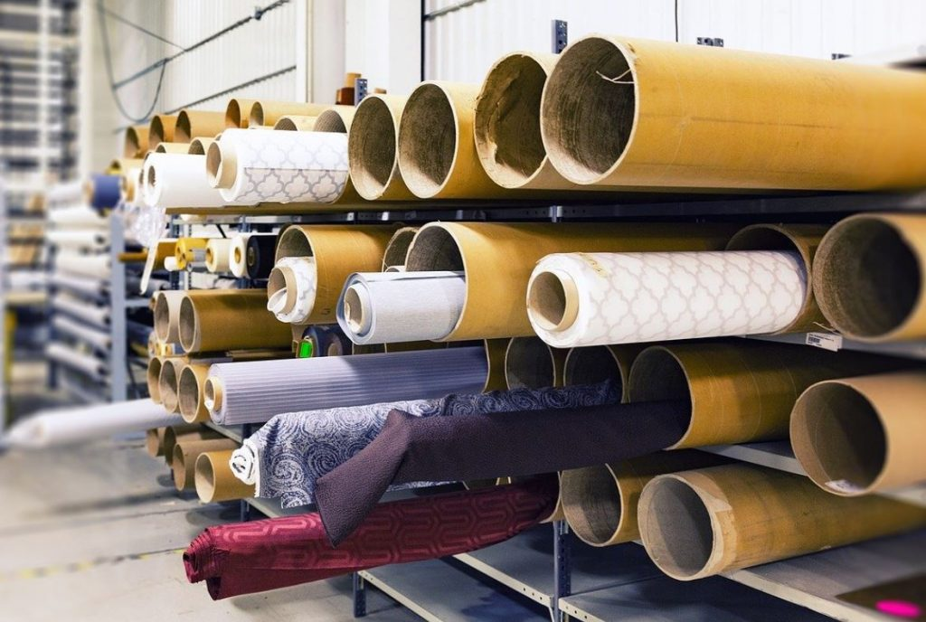 Picture of large rolls of fabric at a factory