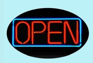An open sign showing the word open in neon red letters inside a neon blue box