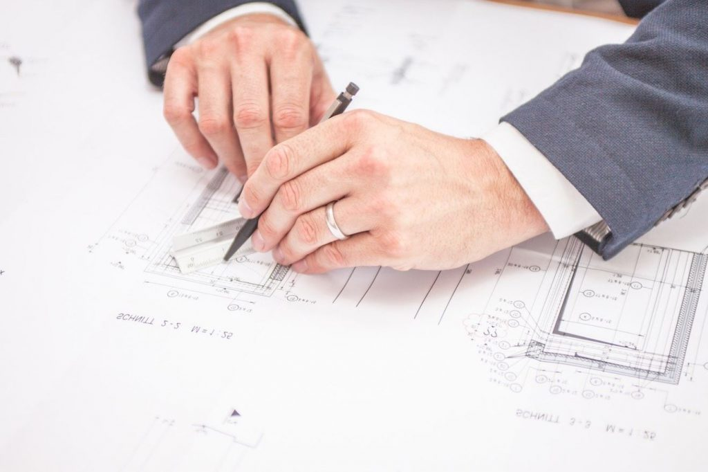 Picture of an architect drawing plans