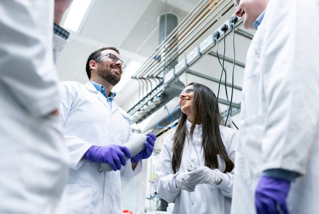 Picture of engineers standing in a laboratory