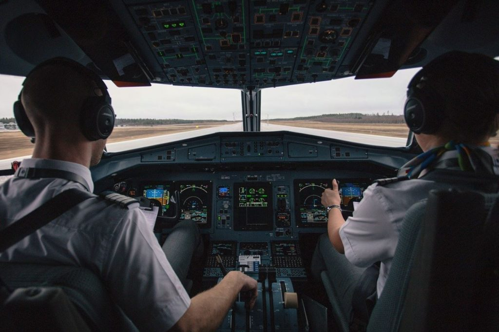 Picture of two pilots in the cockpit of a plane