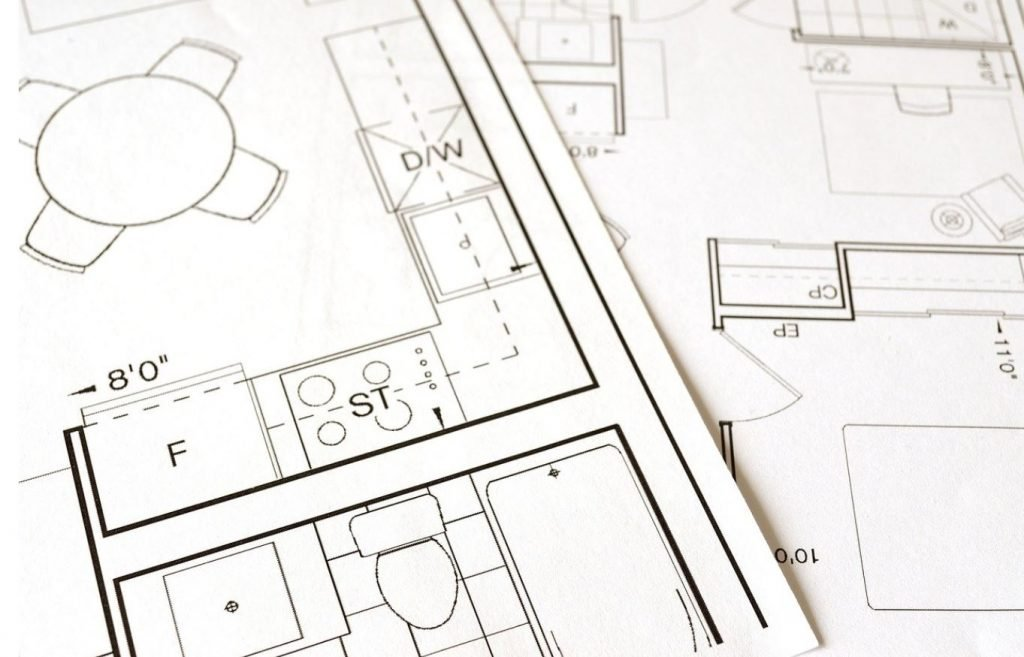Picture of blue prints from a home being flipped